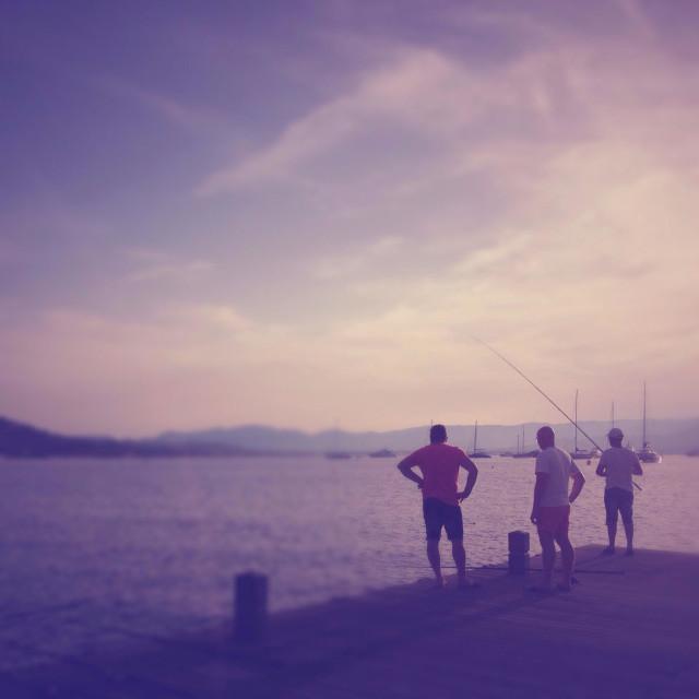 """Men fishing, Mediterranean sea"" stock image"