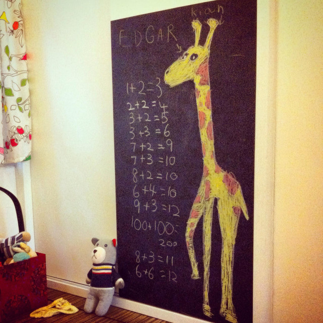 """Girafe & mathematics on a blackboard in a kid's bedroom"" stock image"
