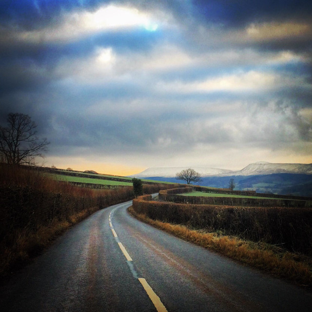 """""""Curved road in Wales heads to the mountain landscape"""" stock image"""