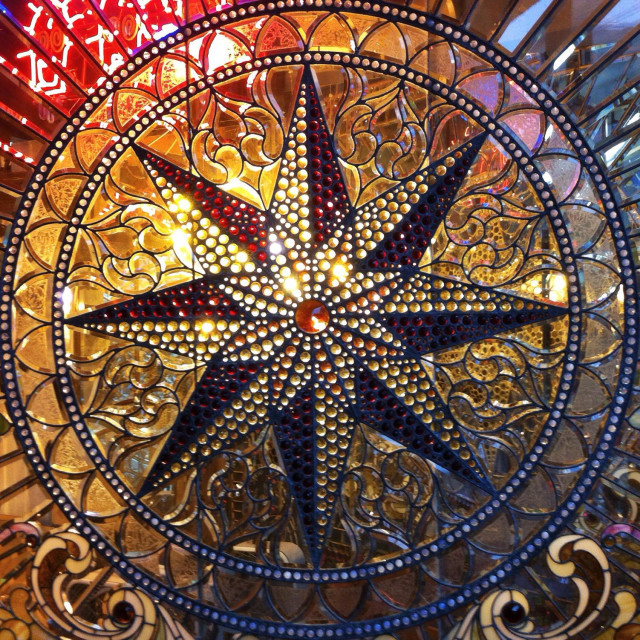 """Stained glass compass rose in round cartouche"" stock image"