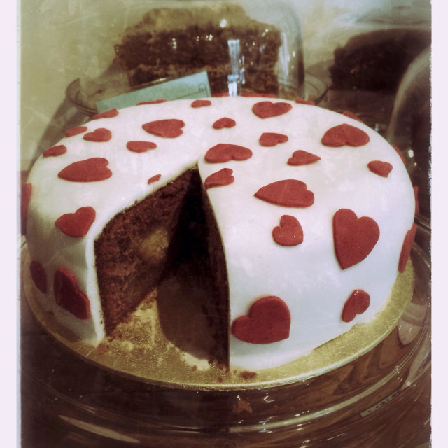 """Valentine cake with slice removed"" stock image"