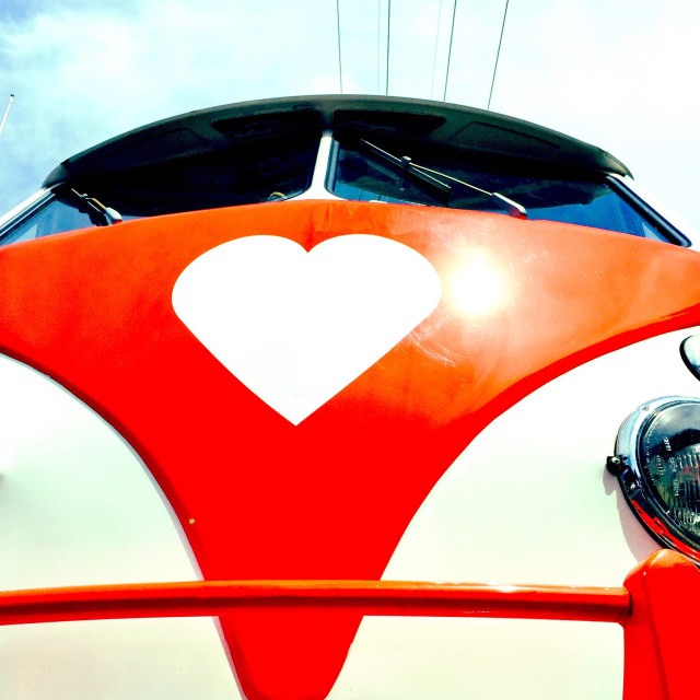 """A vintage VW Campervan with a heart logo"" stock image"