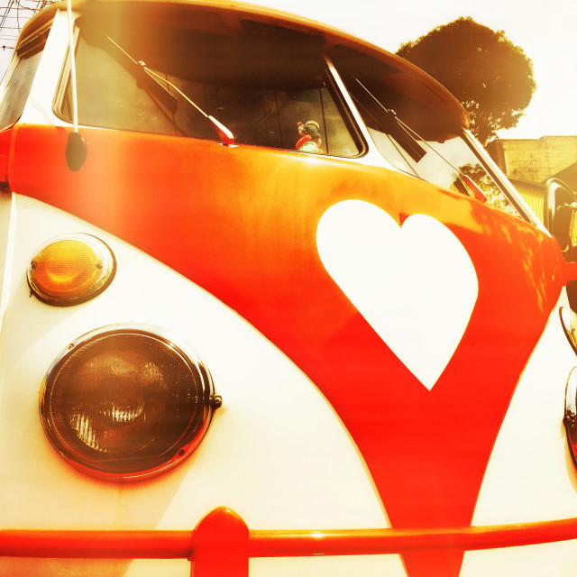 """A vintage VW bus with a heart shaped logo"" stock image"