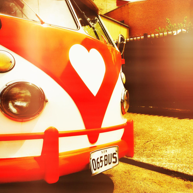 """An old VW bus with a heart logo on the front"" stock image"