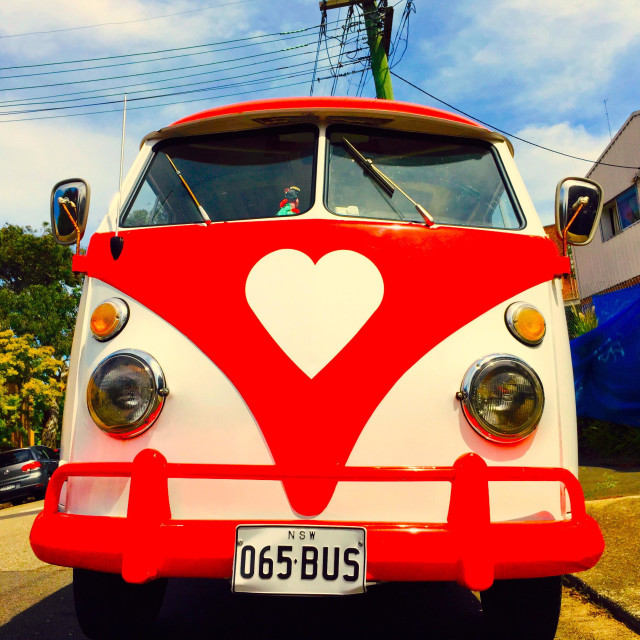 """A vintage VW bus with a heart-shaped logo"" stock image"