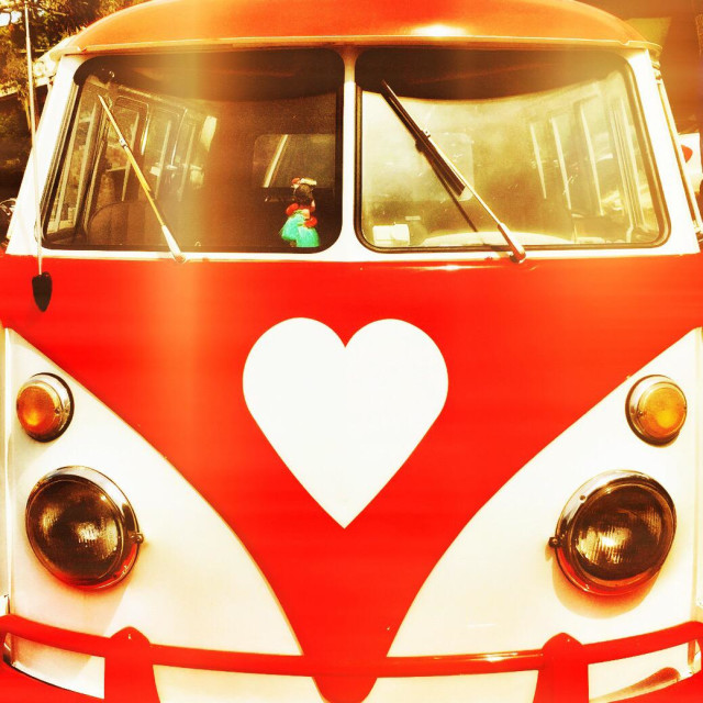 """Vintage VW camper with a heart-shaped logo in red"" stock image"
