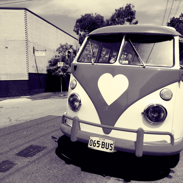 """An old VW bus with a heart logo"" stock image"