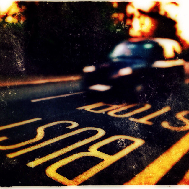 """""""Black taxi cab passing a bus stop, Harrow-on-the-hill, North West London, England, United Kingdom, Europe"""" stock image"""