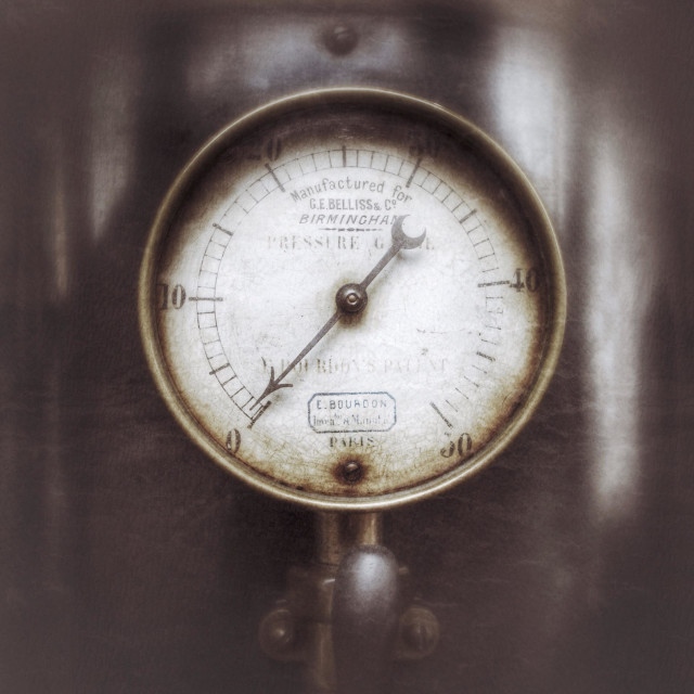 """Under pressure. Circular pressure gauge on an old boiler."" stock image"