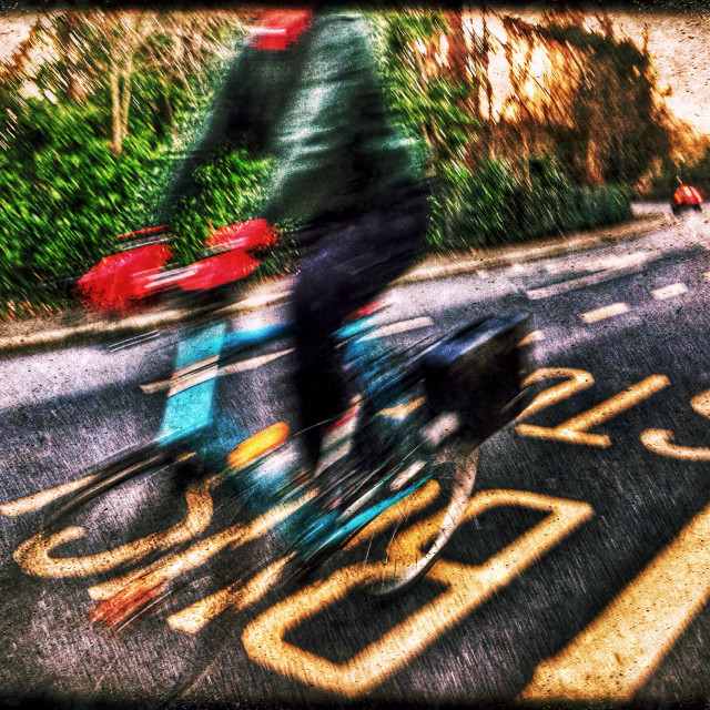 """""""Blurred Cyclist, Harrow on the Hill, North West London, England, United Kingdom, Europe"""" stock image"""