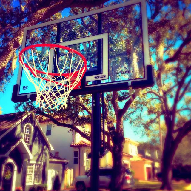 """""""Basketball hoop in residential neighborhood"""" stock image"""