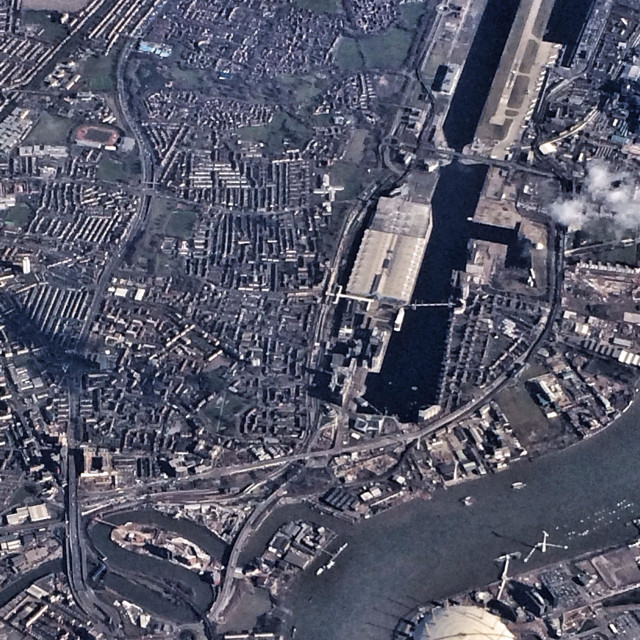 """Looking out of plane window down over London including River Thames and O2"" stock image"