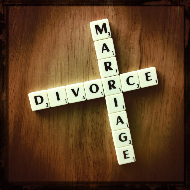 """MARRIAGE & DIVORCE spelled out in scrabble tiles"" stock image"