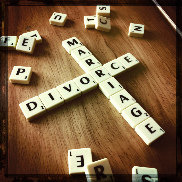 """MARRIAGE & DIVORCE spelled out with scrabble tiles on table"" stock image"