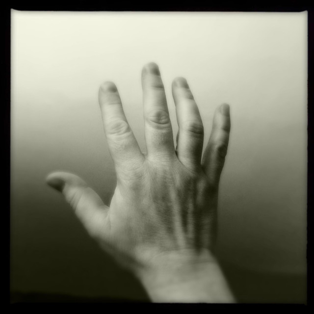 """""""Man's hand reaching out"""" stock image"""