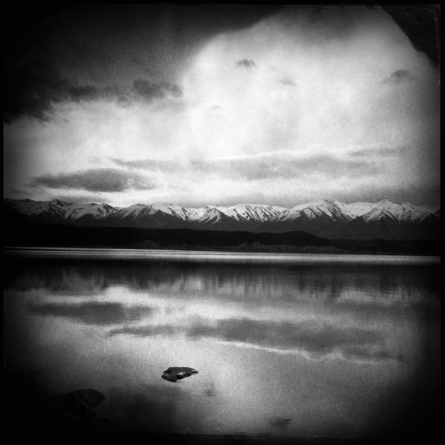 """Reflections of the Southern Alps and the clouds in Lake Pukaki, Mackenzie District, New Zealand."" stock image"