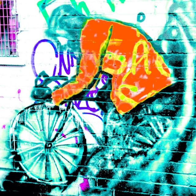"""Graffiti of bike and rider on wall"" stock image"