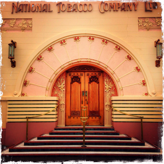 """""""Picture shows the entrance to the National Tobacco Company in Napier, New Zealand, and is one of the finest examples of Art Deco building in the city."""" stock image"""