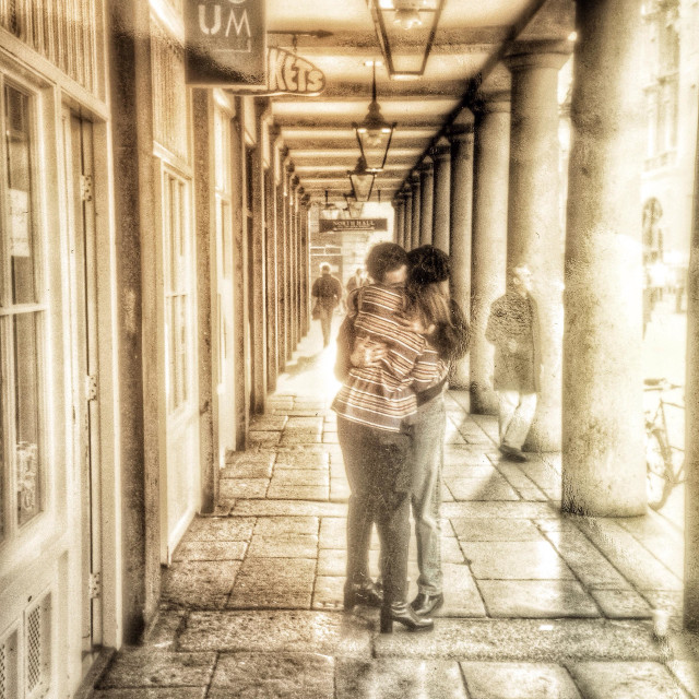 """A couple embrace in Covent Garden"" stock image"