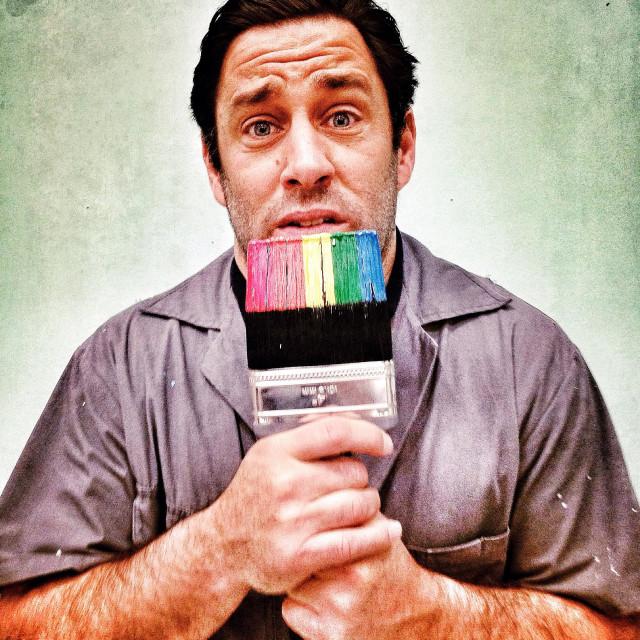 """Creepy handyman painter holding rainbow paint brush funny"" stock image"
