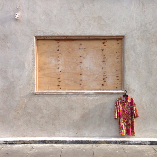 """""""A Hawaiian shirt hanging from a boarded up window in Clarence Rd, Hackney, London"""" stock image"""