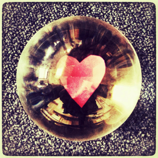 """""""Paper heart reflected in As glass crystal ball."""" stock image"""