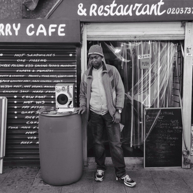 """""""Lason Duncen outside his restaurant in Brixton archways. He opened his shop 7 years ago but unfortunately he has to move out due to a proposed redevelopment of his shop planned by Network Rail."""" stock image"""