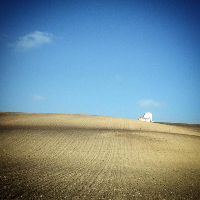 """A desertic deforested monoculture landscape in Arcos de la Frontera, Sierra de Cadiz, Andalusia, Spain"" stock image"