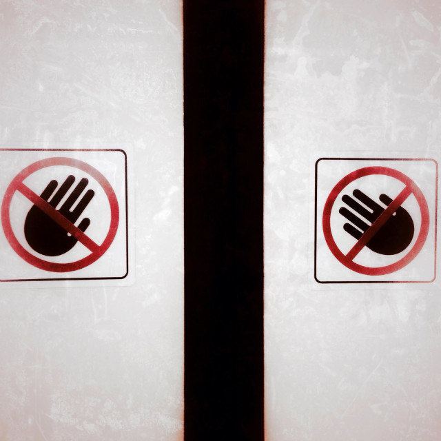 """Signs requesting people do not push on the glass."" stock image"