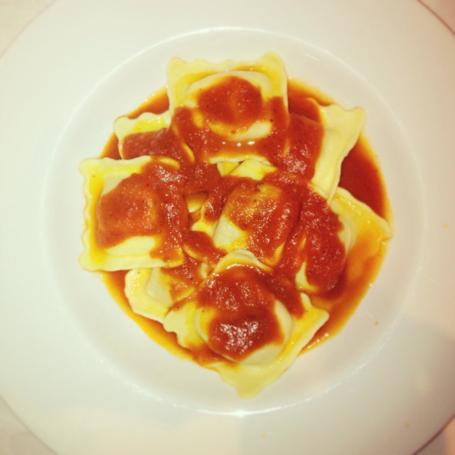 """Crab ravioli and tomato sauce"" stock image"