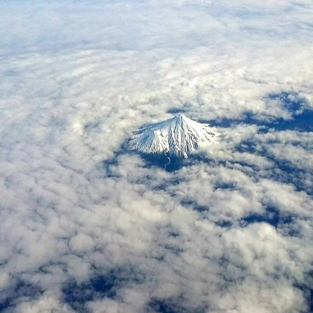 """Fire and Ice Mount Taranaki/Egmont from the air"" stock image"