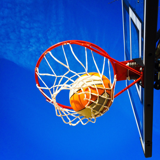 """""""Ball, hoop, net and backboard against the blue sky"""" stock image"""