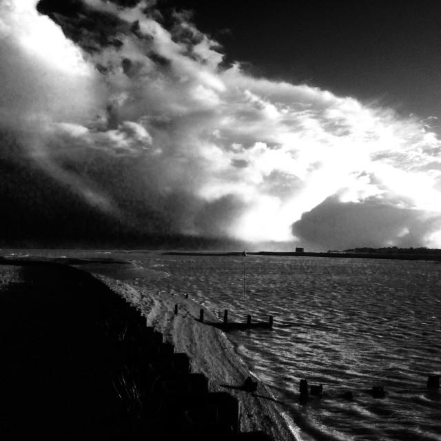 """Storm clouds across the river Deben estuary, Suffolk, UK."" stock image"