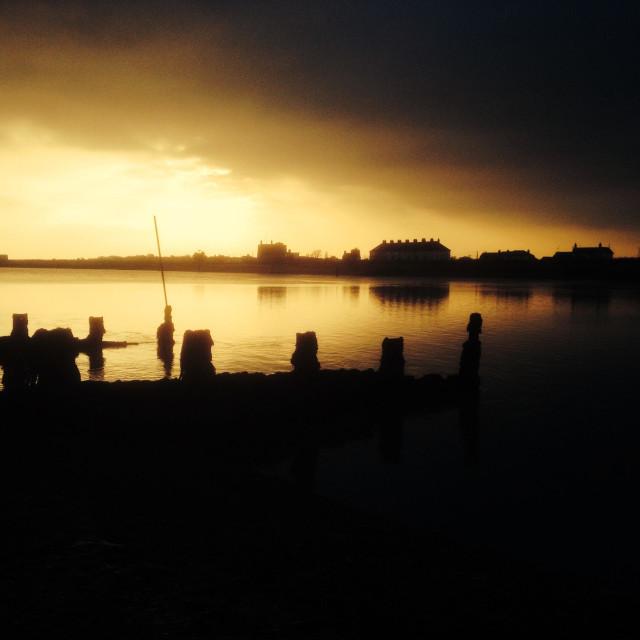 """Sunset over the river Deben, Felixstowe Ferry, Suffolk, UK."" stock image"