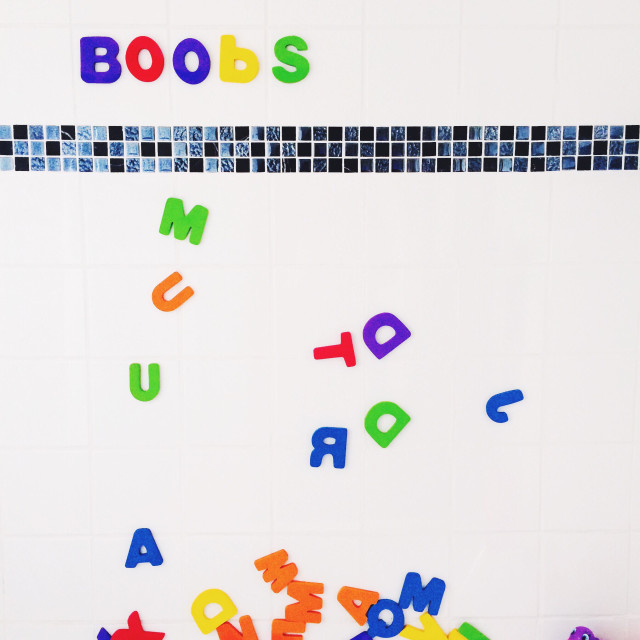 """""""Boobs spelt out in letters on bathroom wall"""" stock image"""