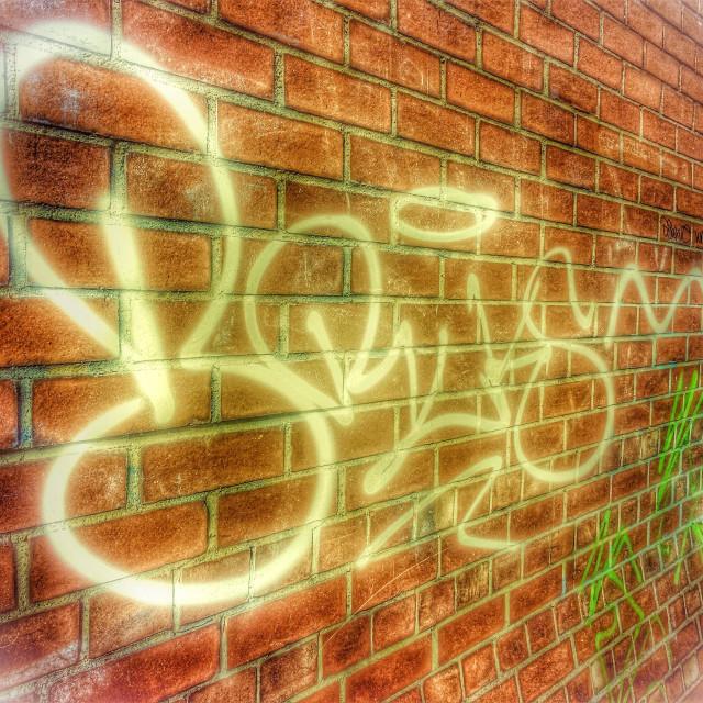 """""""Graffiti tags on a brick wall"""" stock image"""
