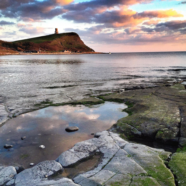 """Clavell tower from Kimmeridge Bay in Dorset."" stock image"