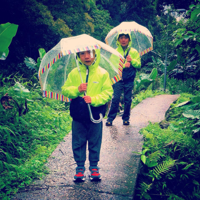 """2 boys with umbrealla under the rain"" stock image"