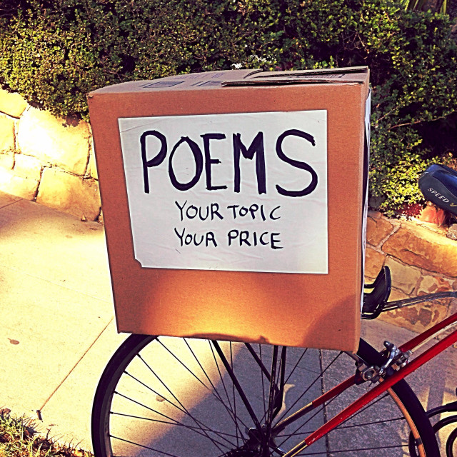 """Sign for poems on the back of a roving artists bicycle in Santa Barbara, Cailfornia"" stock image"
