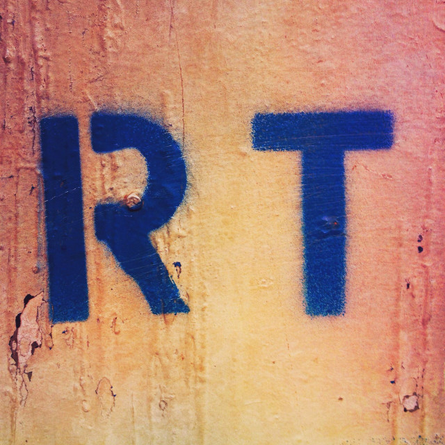 """""""Spray painted blue letters 'RT'"""" stock image"""