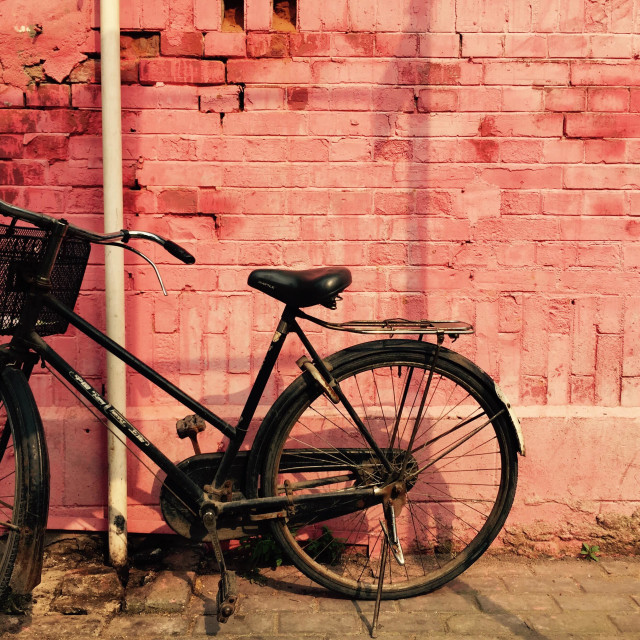 """""""Bike against a red wall"""" stock image"""
