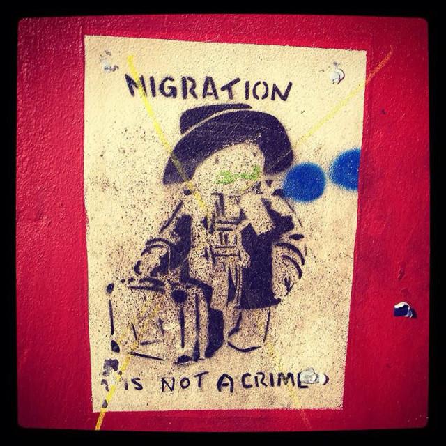 """Paddington Bear immigration graffiti in Bristol, England."" stock image"