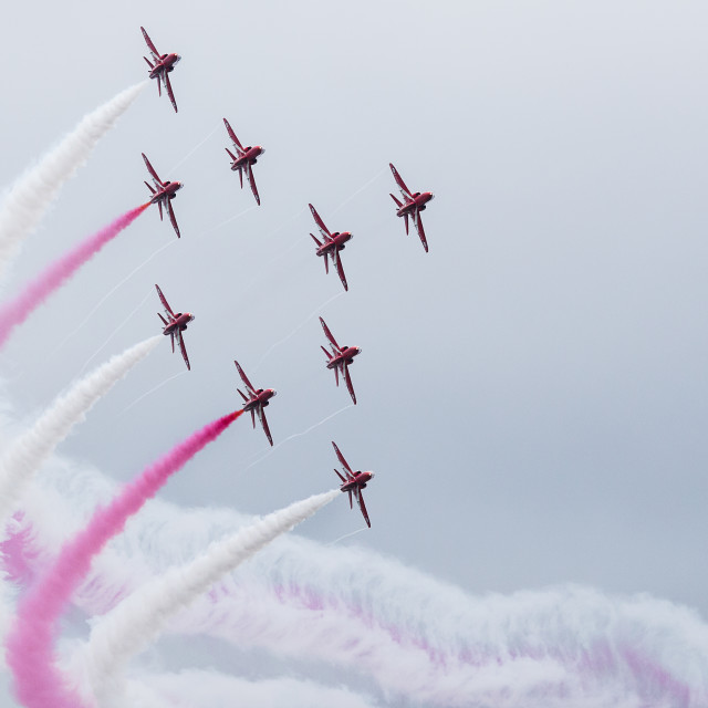 """Red Arrows trailing red and white smoke in their Typhoon formation"" stock image"