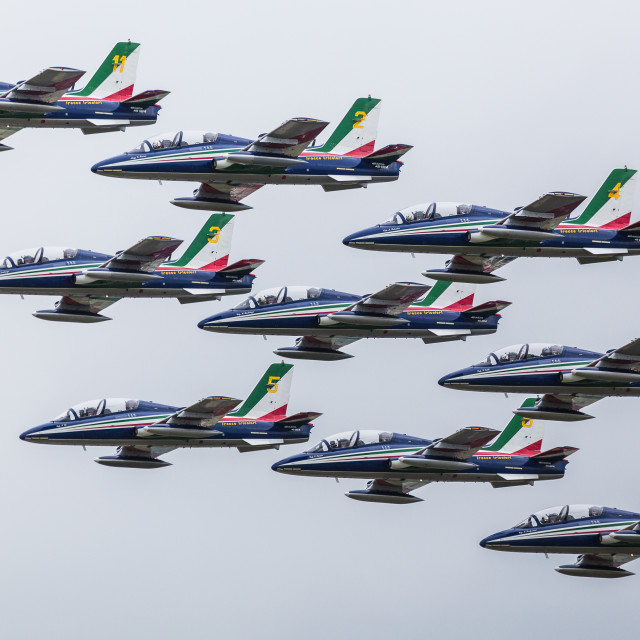 """Nine of the Frecce Tricolori display team in tight formation"" stock image"