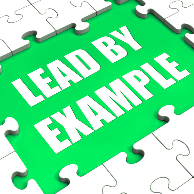 """""""Lead by Example Puzzle Shows Leading Leadership And Motivation"""" stock image"""