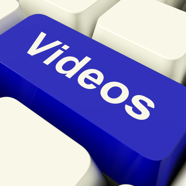 """""""Videos Computer Key In Blue Showing Dvd Or Multimedia"""" stock image"""