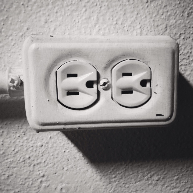 """""""Electrical socket on a white wall"""" stock image"""