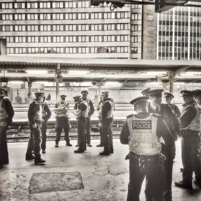 """Metropolitan and British transport police on duty at Victoria station."" stock image"