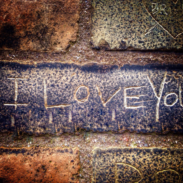 """""""I love you carved into a brick wall"""" stock image"""