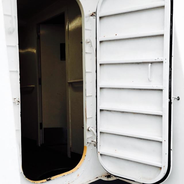 """Ship's white watertight compartment door"" stock image"